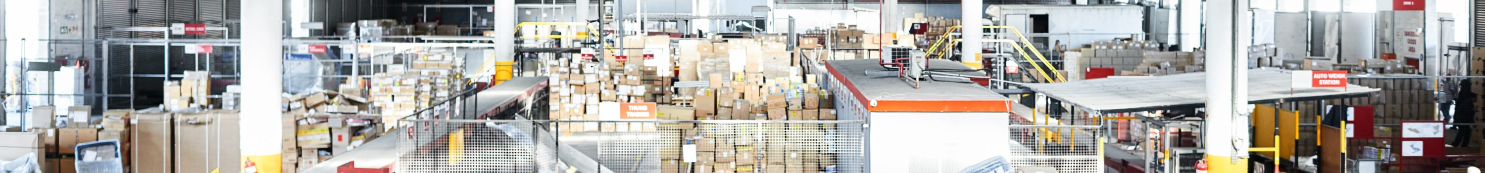 Shot of a large distribution warehouse full of boxes and containers
